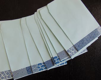 ZEN COLLECTION: 55 pockets blue sky decorated with a masking tape graphic border blancghe and blue