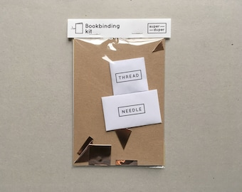 DIY bookbinding kit with paper, needle, thread and real copper sticker