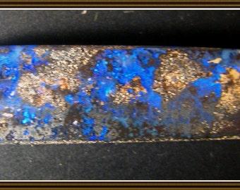 Boulder Opal cabochon,  48.5x11.5x6mm, 35.35 cts.