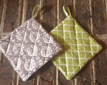 Quilted potholders in green and grey reversible prints , 7 inch square