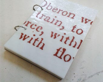 Refillable A5 glass covered sketchbook or notebook, with giant text from Shakespeare printed on white fused glass.