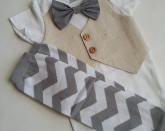 Baby Boy Bodysuit With An Ivory Linen Vest Attached, A Grey Bow, And Matching Leg Warmers set.