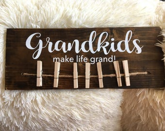 GRANDKIDS make life grand.  Rustic sign with 7 clothespins. Handmade and painted. Grandparents grandchildren photo sign
