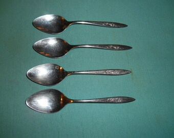 "Four (4), Stainless, 7"", Place / Oval Soup Spoons, from Imperial International, in the Silver Dawn Pattern."
