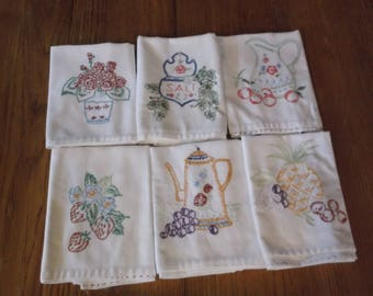 Set of six vintage, embroidried dish towels, made of feed sack fabric.