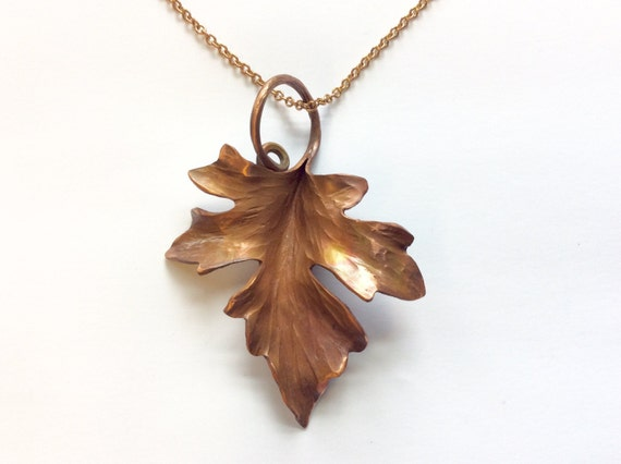 An artfully smithed copper maple leaf pendant on a 20 inch brass chain - made to order
