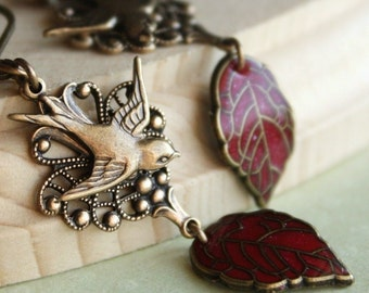 Bird leaf dangle earrings ruby red swallow leaves nature