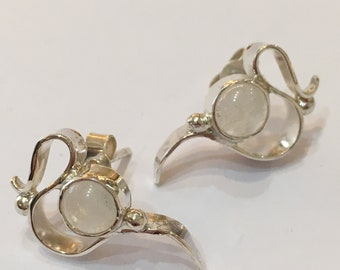 Solid silver wave design stud earrings with moonstone