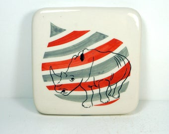 tile with red and grey gray background and a Rhino print, ready to ship