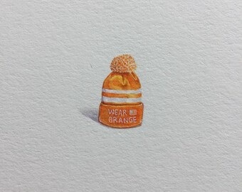 Miniature Painting of a WEAR ORANGE hat by Brooke Rothshank