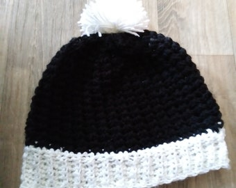 Crochet child's beanie with pompom