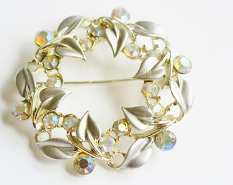 BSK Designed Vintage Gold Tone Wreath Circle Brooch Pin with Silver Enamel Painted Leaves and Faceted Aurora Borealis Rhinestones