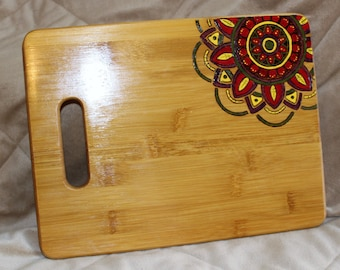 Wood burned cutting board with Mandala
