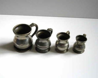 Set Of Three Wine/Spirit Measuring Jugs Plus One Other