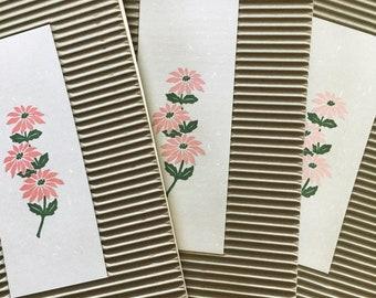 Skinny spiral-bound floral journals
