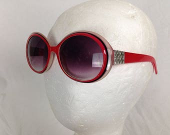 Red frame round glasses