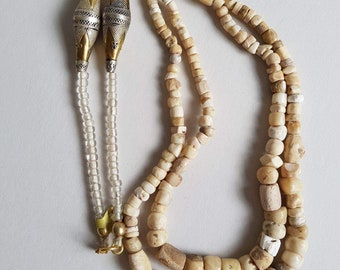 Double strand ancient excavated stone beads, with silver goldwash bicones from Turkmenistan . N157