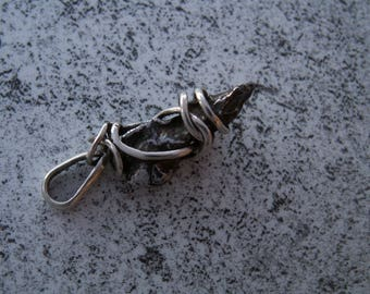 Pendant in silver with a iron meteorite Sikhote Alin