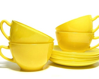 Four Mid Century Bright Yellow Glass Cups and Saucers Platonite