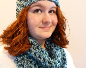 Hat and scarf set in shades of blue and green.