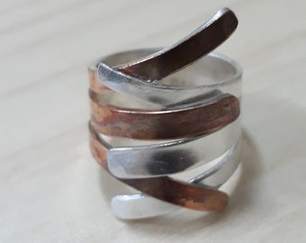 Sterling silver ring with copper or brass  onto it. Adjustable. Original design.