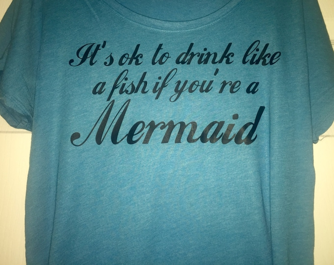 It's ok to drink like a fish if your a mermaid. Funny mermaid tshirt. Drinking shirts. Mermaid off the shoulder t shirt . Mermaid dolman.