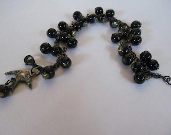 Charm Bracelet, vintage black glass shoe buttons attached to chain.