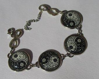 """yin and yang"" bracelet arabesque pattern"