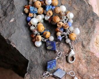 Lapis fringe bracelet. psychic healing integrity gemstones / pearls / picture dalmation jasper / sodalite / feldspar / blue brown beads