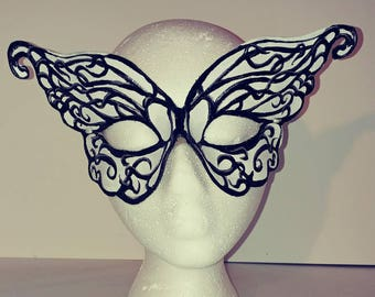 Small Leather butterfly mask tooled and painted in black white and silver.