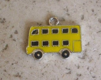 2 yellow epoxy metal bus charms