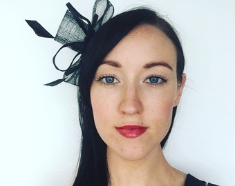 Black Fascinator adorned with feathers and black embellishment at its centre