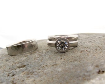 Palladium and Forever One moissanite engagement ring and wedding band set hammered textures and bezel set stone wide band