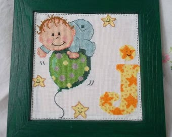 "Wood frame with embroidered ""J"" baby alphabet"