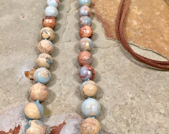 Boho style aqua terra jadper beaded necklace with a rich brown leather strap