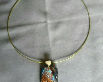 Multicolored dichroic pendant on deep red background glass with gold colored choker and adorable heart shaped bail