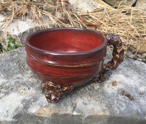 medium sized handled soup bowl in red, black, and tan
