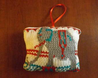 Hand knitted circus elephant door pillows