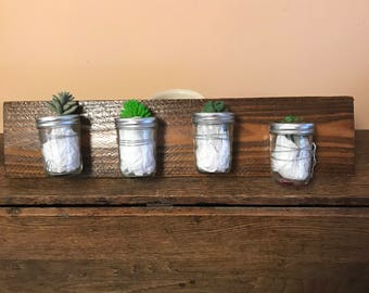 Handmade wooden wall hanging sign with jars