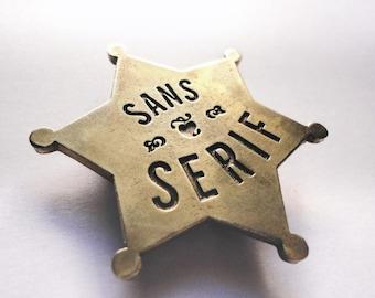 San Serif badges