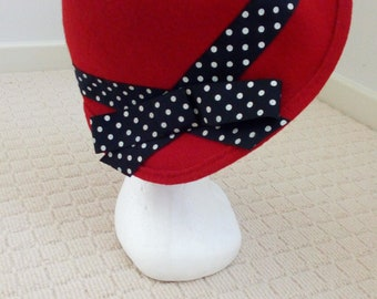 Red felt cloche with black and white spot petersham trim