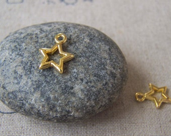 50 pcs of Gold Tone Filigree Star Frame Charms 10mm A4497