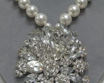 Massive statement necklace. Huge rhinestone pendant with white 14mm Swarovski pearls.