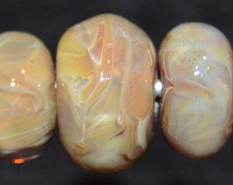Gold dust seven lampwork beads SRA K45