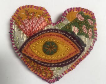 Big Eye- embroidered heart pillow with evil eye