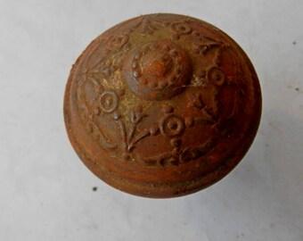 one antique stamped iron door knob vintage architectural salvage