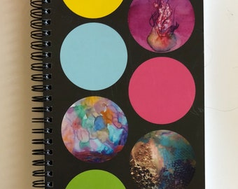 Dotted spiral notebook