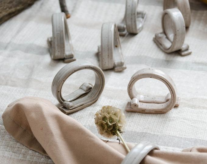 Vintage set of 8 ceramic napkin rings