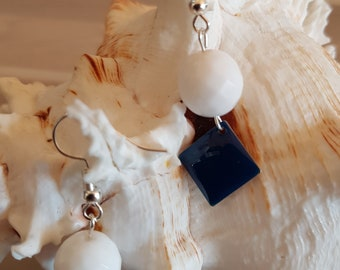Earrings silver, faceted round white, blue enamel square charms.