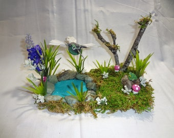 Fairy garden pond with hummingbird